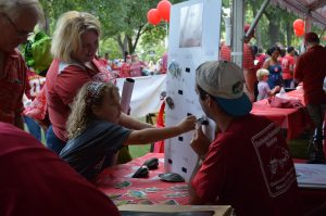 students entertain visitors at Homecoming event