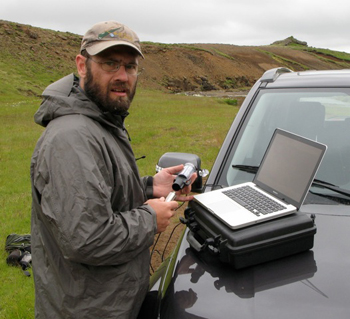 Dr. Jon Benstead downloading temperature data from a data logger installed at his field site in western Iceland.